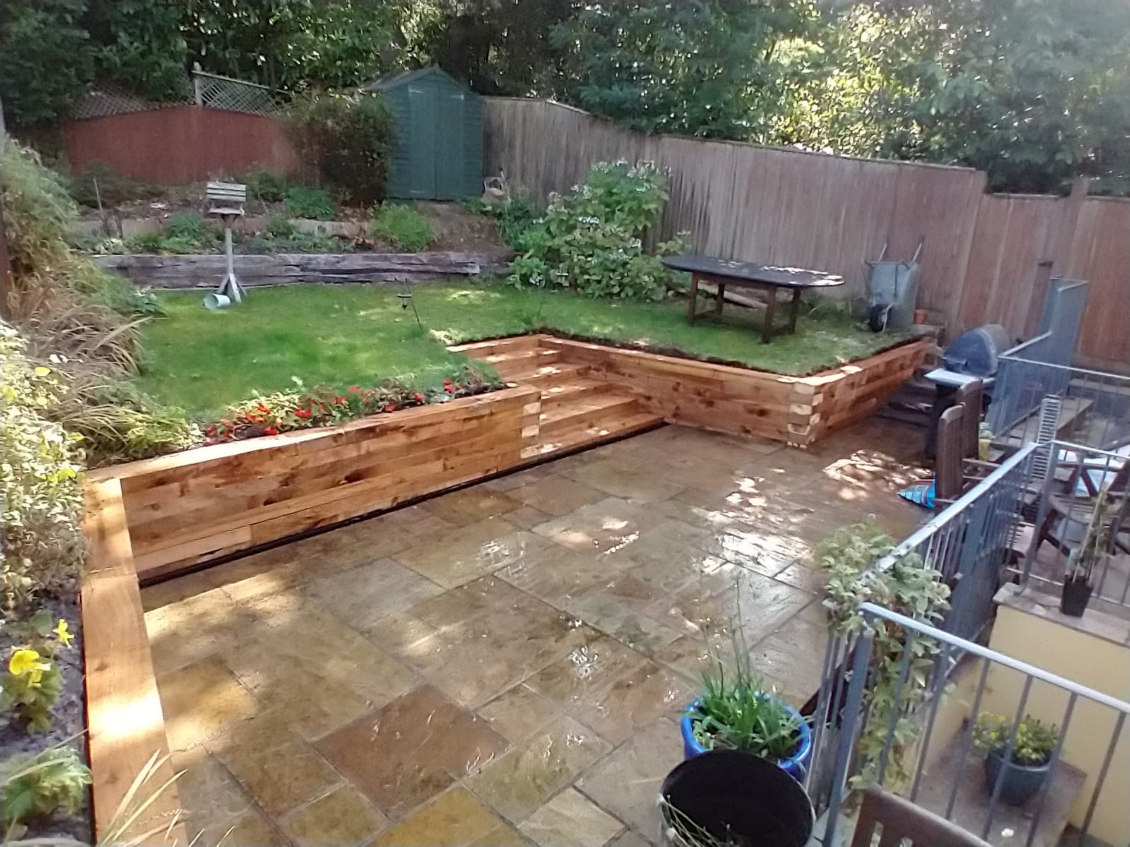 Hardwood retaining wall with steps.