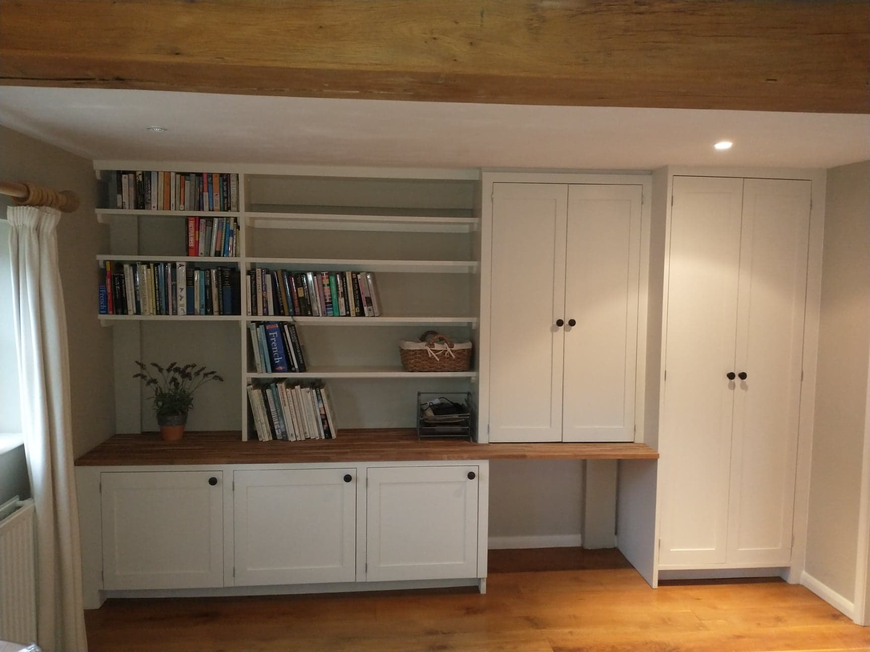 Bespoke cabinets and shelving with oak worktop.